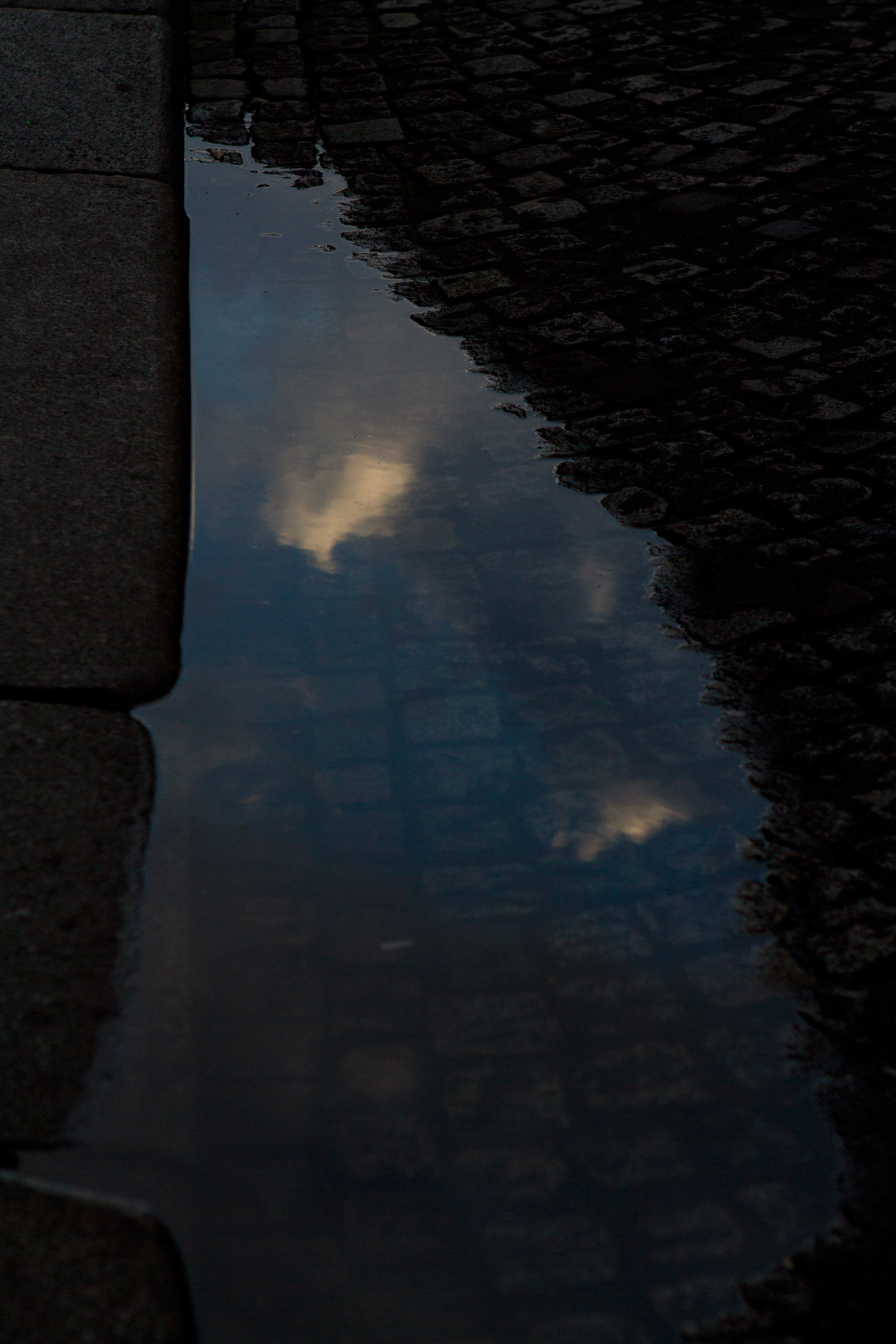 cloud-puddle-reflection-paris-cobbles-street