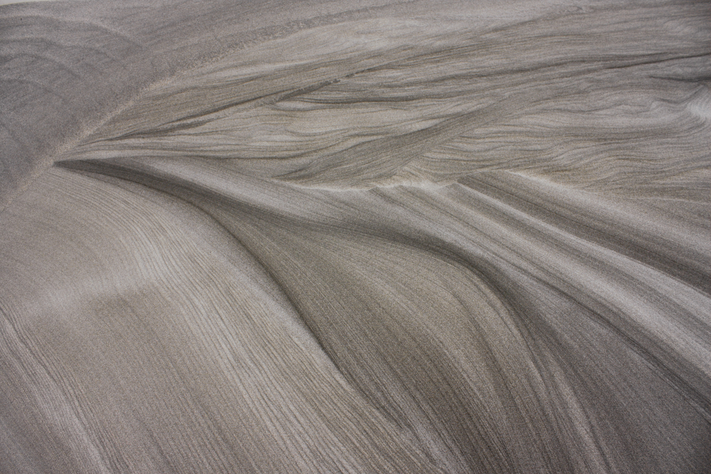 sand-patterns-wind-art-black-sand
